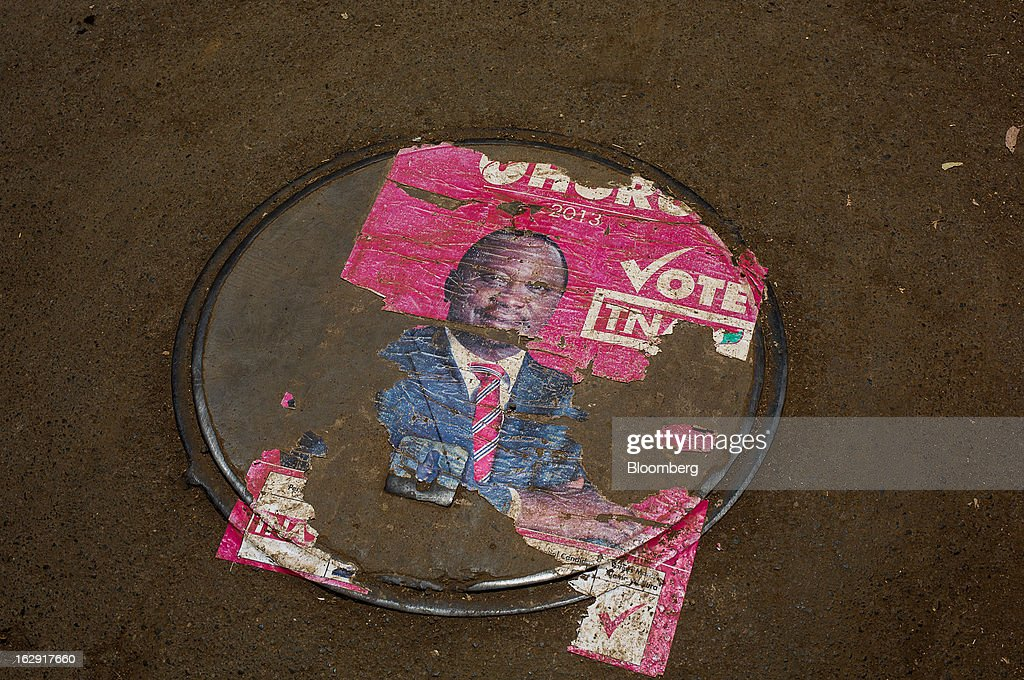 An election poster for Uhuru Kenyatta, Kenya's deputy premier, lies on a street ahead of the presidential election in Nairobi, Kenya, on Friday, March 1, 2013. Next week's presidential vote will be the first since disputed elections in 2007 triggered ethnic fighting in which more than 1,100 people died and another 350,000 fled their homes. Photographer: Trevor Snapp/Bloomberg via Getty Images