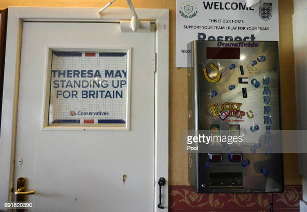 An election poster is seen at an election campaign event during a visit to West Yorkshire at Thornhill Cricket and Bowling Club on June 3 2017 in...