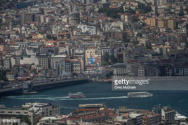 An election poster showing the portrait of Turkey's President Recep Tayyip Erdogan is seen amongst buildings during a Kaan Air helisightseeing tour...