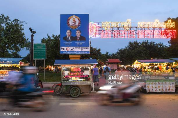 An election poster with images of Heng Samrin Honorary President of the Cambodian People's Party and Hun Sen Prime Minister of Cambodia and President...