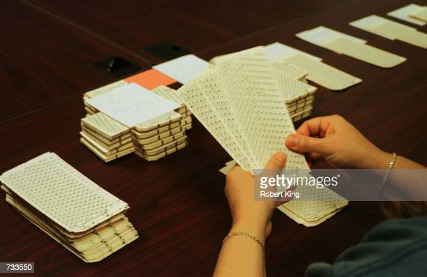 An election worker counts ballots November 19 2000 during the hand recount of presidential ballots at the Broward County Emergency Operations Center...