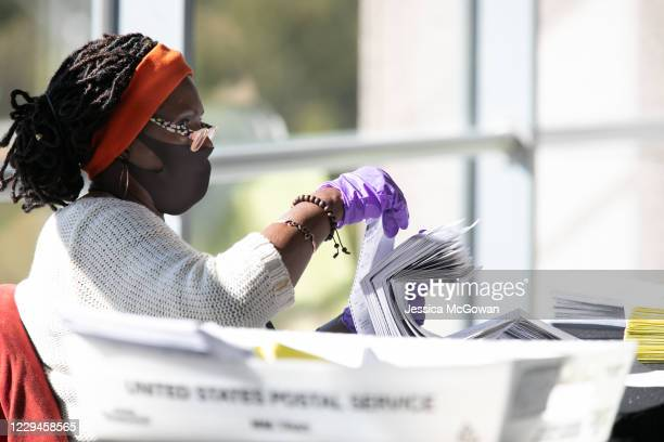 An election worker counts Fulton County ballots at State Farm Arena on November 4 2020 in Atlanta Georgia The 2020 presidential race between...