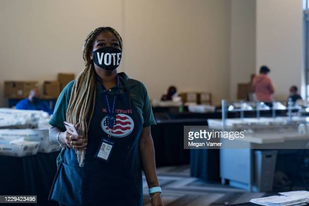 An election worker processes absentee ballots at State Farm Arena on November 2, 2020 in Atlanta, Georgia. With record-breaking early voting turnout,...