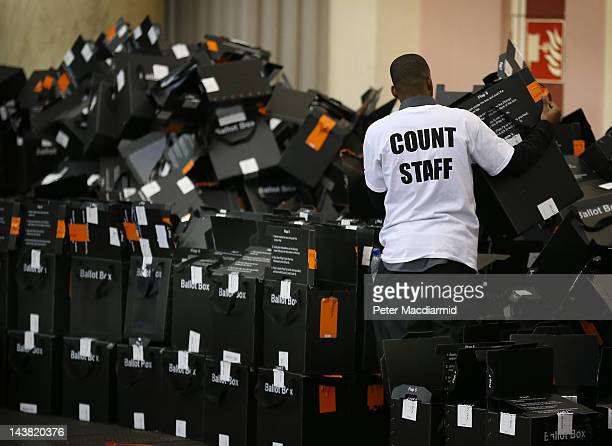 An election worker tidies up empty ballot boxes at the Alexandra Palace vote counting centre on May 4 2012 in London England Full results and final...