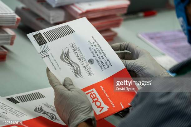 An elections worker opens ballots at the King County Elections headquarters on August 4, 2020 in Renton, Washington. Today is election day for the...