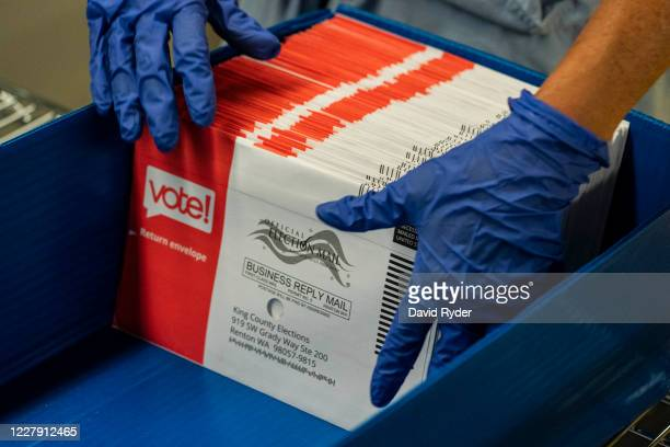 An elections worker sorts unopened ballots at the King County Elections headquarters on August 4, 2020 in Renton, Washington. Today is election day...