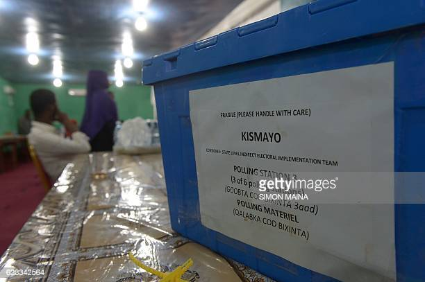 An electoral agent sits next to ballot boxes as he awaits their collection in Kismayo on November 15 2016 Somalia is in the process of selecting a...