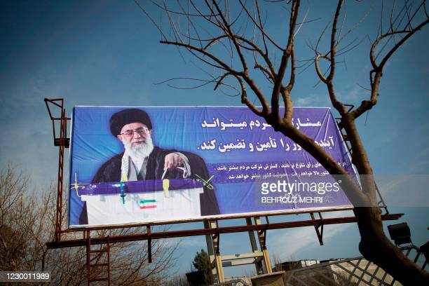 An electoral banner with a portrait of Iran's supreme leader, Ayatollah Ali Khamenei is seen south of Tehran on February 28, 2012. Portraits of...