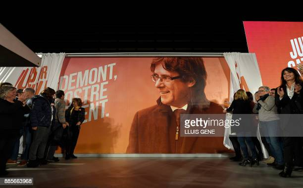 An electoral billboard with the image of 'Junts per Catalonia' grouping cadidate for the upcoming Catalan regional election Carles Puigdemont is...