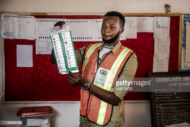 An electoral commission officer counts votes at Shagari Health Unit polling station in Yola Adamawa State on February 23 2019 after the polls were...