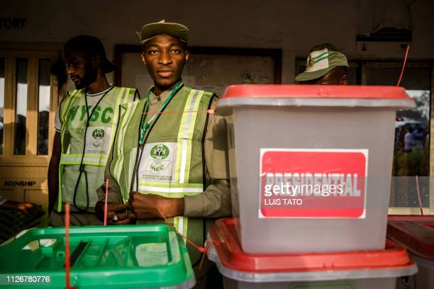 TOPSHOT An electoral commission officer prepares polling materials for the presidential election at Shagari Health Unit polling station a few hours...