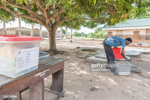 An electoral commission official sets up a ballot box at a polling station at the Dakpa primary school in Save, Benin, on April 11 while waiting for...