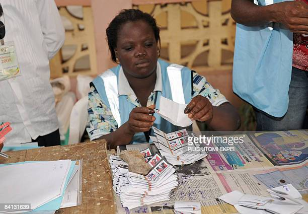 An electoral officer counts the ballots at a polling station after the presidential elections on December 28 in Accra Ghanaians turned out today to...