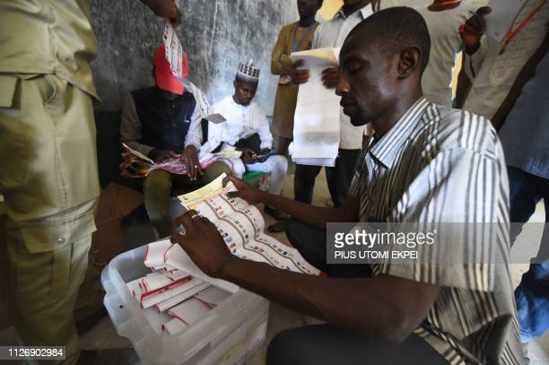 An electoral officer sorts out ballot papers to count vote after the polls closedat a polling station in Kano commercial capital of northern Nigeria...