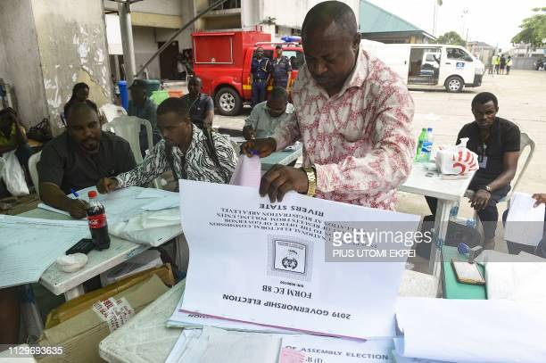 An electoral official looks at documents at the state headquarters of the Independent National Electoral Commission in Port Harcourt Rivers State on...