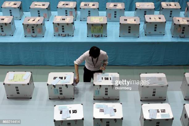 An electoral official prepares ballot boxes for the general election for counting at the Himeji City Office in Himeji Hyogo Prefecture Japan on...