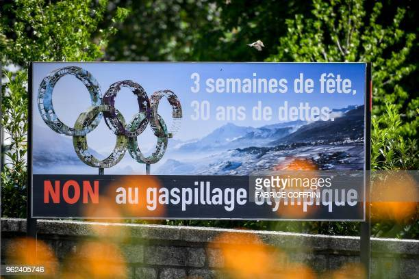 An electoral placard against Sion 2026 Winter Olympics bid to be voted on June 10 2018 by citizens of the canton of Valais is seen in Collombey on...