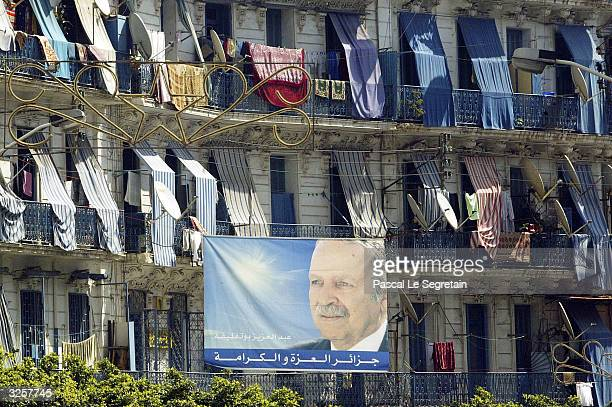 An electoral poster of presidential candidate President Abdelaziz Bouteflika is seen outside a building on the countries election day April 8 2004 in...