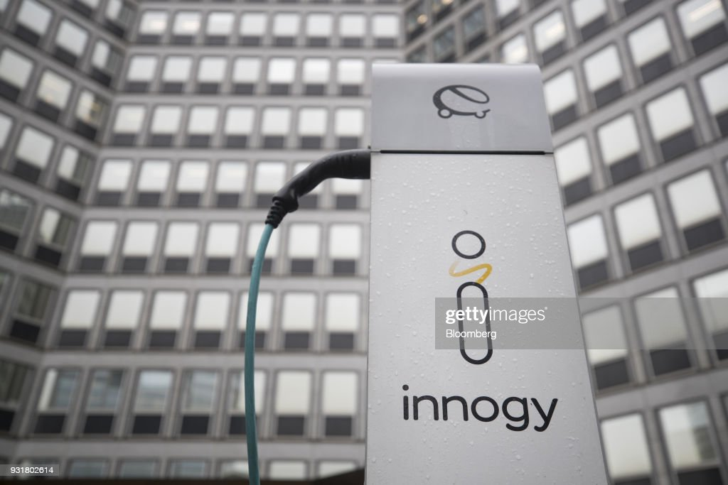 An electric automobile charging station, operated by Innogy SE, stands outside the headquarters of RWE AG in Essen, Germany, on Tuesday, March 13, 2018. EON SE will shed as many as 5,000 jobs in the deal to take over Innogy, a move that marks the biggest shakeup in Germany's energy business in years. Photographer: Jasper Juinen/Bloomberg via Getty Images