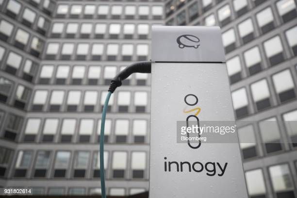 An electric automobile charging station operated by Innogy SE stands outside the headquarters of RWE AG in Essen Germany on Tuesday March 13 2018 EON...