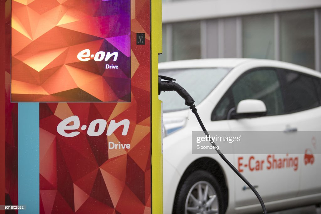 An electric automobile sits at a charging station outside the headquarters of EON SE in Essen, Germany, on Tuesday, March 13, 2018. EON will shed as many as 5,000 jobs in the deal to take over Innogy SE, a move that marks the biggest shakeup in Germany's energy business in years. Photographer: Jasper Juinen/Bloomberg via Getty Images