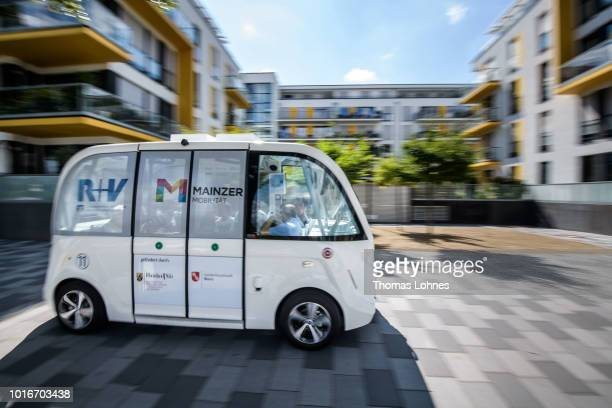 A passenger talks to an operator in an electric autonomous bus on August 14 2018 in Mainz Germany Called EMMA the bus is made by Navya and will...