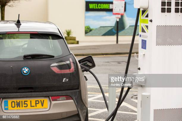 an electric bmw being recharged at a motorway service station on the m6 motorway, uk. - bmw stock pictures, royalty-free photos & images