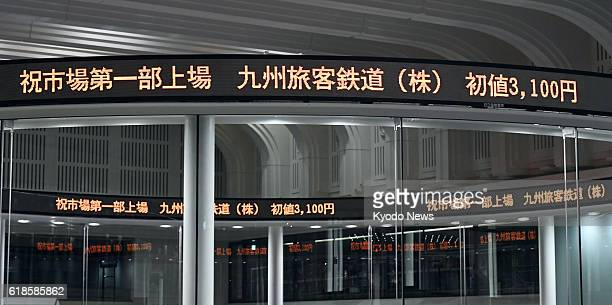 An electric board in Tokyo shows Kyushu Railway Co shares opening at 3100 yen on Oct 25 when the southwestern Japan railway debuted on the First...