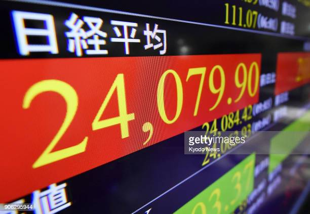 An electric board in Tokyo shows the benchmark Nikkei stock index retaking the 24000 line on the morning of Jan 18 for the first time since November...