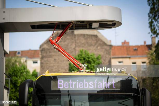 An electric bus is pictured during the charge process on April 24 2018 in Berlin Deutschland