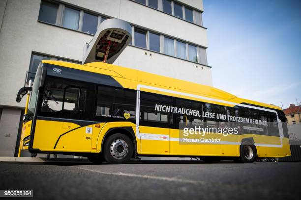 An electric bus is pictured during the charge process on April 24 2018 in Berlin Germany