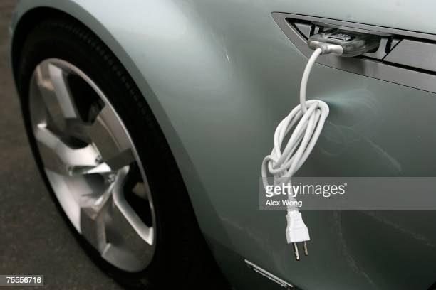 An electric cable is attached to the side of a Chevrolet Volt vehicle during a viewing on Capitol Hill July 19 2007 in Washington DC The Volt is a...