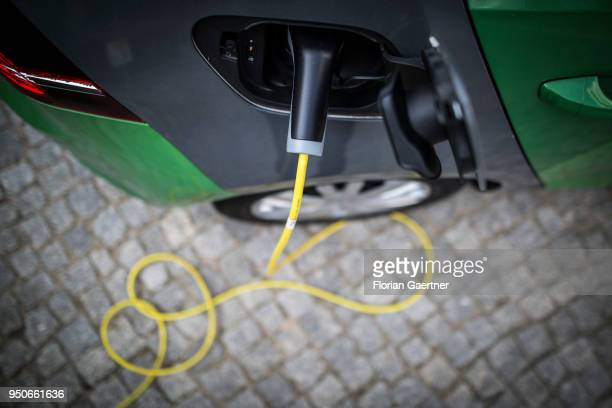 An electric car is pictured during charging on April 24 2018 in Berlin Germany