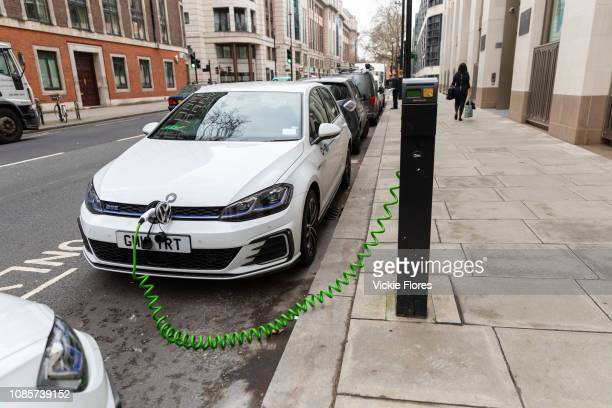 An electric car is seen charging at a charging point on the street in Westminster central London UK on January 11 2019