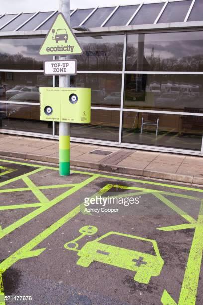 An electric car recharging station at an M6 motorway service station, Lancashire, UK.