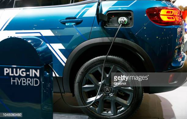 An electric charger for a Citroen SUV C5 Air Cross plugin hybrid automobile is on display during the second press day of the Paris Motor Show at the...