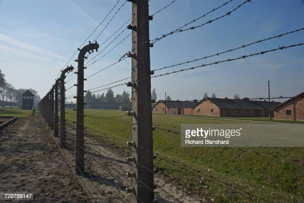 An electric fence at the Auschwitz-Birkenau Memorial and Museum, site of the Auschwitz Birkenau German Nazi concentration and extermination camp in...