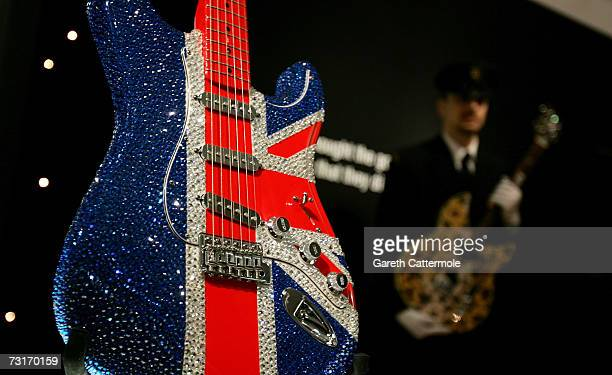 An electric guitar 'London Birth of a Cult' customised by Hedi Slimane and covered in Swarovski crystals is displayed at the Born To Rock Exhibition...
