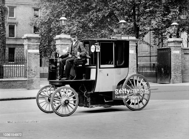 An electric motor cab and driver London c1897c1900 This early cab was evidently based on the design of the horsedrawn hansom cab Cars of any kind...