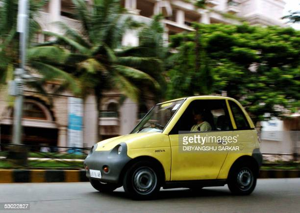 An electric Reva motorcar drives down the street during a rally to celebrate World Environment Day in Bangalore 05 June 2005 The rally was organised...