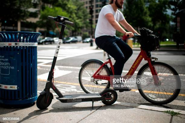 An electric scooter belonging to the Bird company is waiting for a rider on a street of downtown Washington DC on June 21 2018 How fast is the...