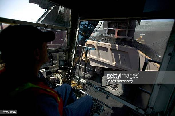 An electric shovel operator loads a coal hauling truck with 200 tons of coal at the Buckskin Coal Mine on June 13 2006 in Gillette Wyoming The open...
