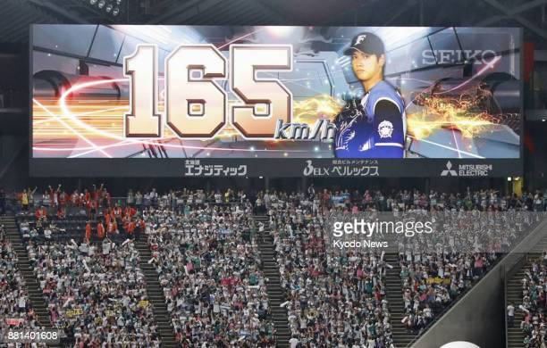 An electric signboard shows Nippon Ham Fighters pitcher Shohei Otani rewriting his own mark by throwing a 165 kilometerperhour pitch during Game 5 of...
