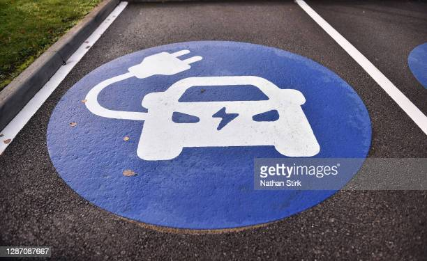An electric vehicle charging pod point logo is seen on November 22, 2020 in Stoke-on-Trent, England. The UK Government released details of its ten...