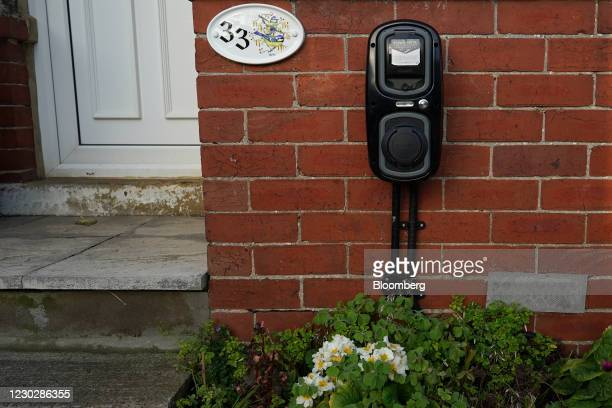 An electric vehicle charging station at a home in Whitby, North Yorkshire, U.K, on Monday, Dec. 14, 2020. U.K. Prime Minister Boris Johnson banned...