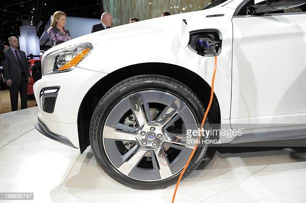 An electrical cord in the outlet for the Volvo XC60 Plugin Hybrid concept car during the first press preview day at the 2012 North American...