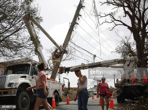 An electrical crew attempts to repair power lines that were knocked over Hurricane Maria passed through on September 27 2017 in Corozal Puerto Rico...