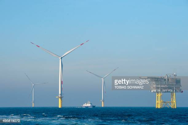 An electrical offshore substation and wind turbines run by Germany's biggest power supplier Eon are pictured at the wind farm 'Amrum Bank West' near...