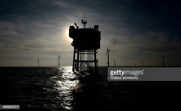 An electrical offshore substation is seen near the wind turbines of the German offshore wind farm 'Amrum Bank West' owned by German energy company...