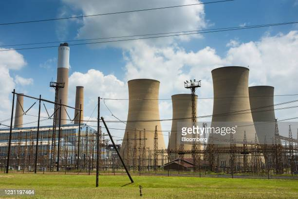 An electrical substation near cooling towers at the Komati coal-fired power station, operated by Eskom Holdings SOC Ltd., in Mpumalanga, South...